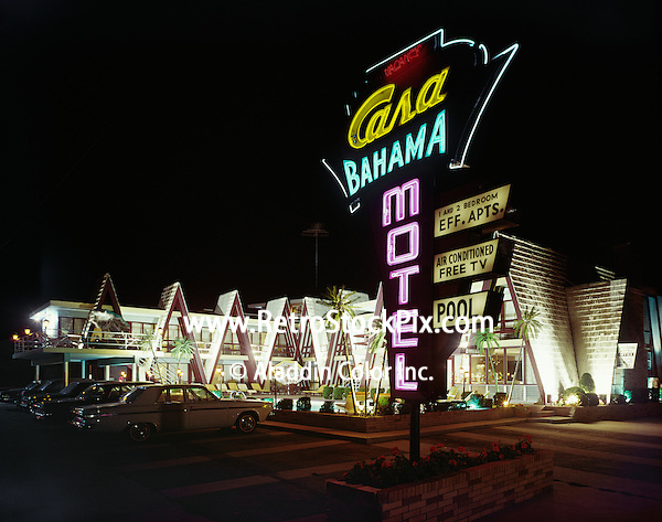 Casa Bahama Motel Exterior at night with large neon sign. 1960's.