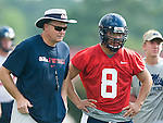 Head coach Houston Nutt, left, and quarterback Jeremiah Masoli watch a play being run as the University of Mississippi began football practice on Sunday, August 8, 2010 in Oxford, Miss. (AP Photo/Oxford Eagle, Bruce Newman).