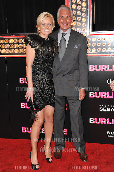 """George Hamilton & Barbara Sturm at the Los Angeles premiere of """"Burlesque"""" at Grauman's Chinese Theatre, Hollywood..November 15, 2010  Los Angeles, CA.Picture: Paul Smith / Featureflash"""