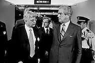 September 27th 1971,  Washington, DC, USA. Arthur Burns (L), Chairman of the Federal Reserve at a General Assembly of the International Monetary Fund (IMF) in 1971 with Former Texas Governor John Connally. In July 1944, representatives from 44 countries assembled at Bretton Woods, USA agreed to create the IMF in order to stabilize the increasingly delicate world economy. In August 1971, American President Richard Nixon (1969-1974) scrapped the gold exchange standard, extending the life of the IMF but pushing it into a secondary role. Only at the beginning of the 1980s, following the crisis of the Third World debt, was the IMF called on again to play a major role in world economy. Connally was appointed as US Treasury Secretary by Nixon the day after the meeting.