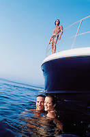 A group of models pose on a searay yacht for a shoot in Ixtap Zihuatanejo,  Mexico 5-19-05