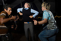 Long Crew dance on the Night Stage: Els, Dustin and Animal. 2006. ..Image from the book project Welcome Home: Building the Michigan Womyn's Music Festival, self-published First-Edition 2009...Photo by Angela Jimenez.copyright 2009 Angela Jimenez Photography