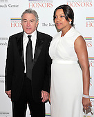 Robert De Niro and Grace Hightower arrive for the formal Artist's Dinner honoring the recipients of the 2011 Kennedy Center Honors hosted by United States Secretary of State Hillary Rodham Clinton at the U.S. Department of State in Washington, D.C. on Saturday, December 3, 2011. The 2011 honorees are actress Meryl Streep, singer Neil Diamond, actress Barbara Cook, musician Yo-Yo Ma, and musician Sonny Rollins..Credit: Ron Sachs / CNP
