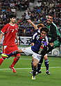 Keigo Higashi (JPN), JUNE 19th, 2011 - Football : Keigo Higashi (C) of Japan bumps goalkeeper Hussain Kankone (R) of Kuwait as Khaled Hajiah (L) of Kuwait looks on in the first half of the Asian men's football qualifiers round 2 for London Olympic game against Kwait national team at the TOYOTA Stadium in Aichi prefecture, Japan on June 19, 2011.Japan beats Kwait 3-1. (Photo by AFLO).