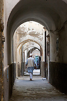 Tripoli, Libya - Man Walking in Medina Passageway