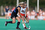 19 September 2014: Virginia's Jess Orrett (ENG) (3) and Duke's Ashley Kristen (CAN) (left). The Duke University Blue Devils hosted the University of Virginia Cavaliers at Jack Katz Stadium in Durham, North Carolina in a 2014 NCAA Division I Field Hockey match. Virginia won the game 2-1.