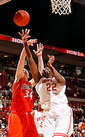 Ohio States Darryce Moore (22) leaps to score guarded by Illinois Jaqui Grant (34) in the second half of their game against the Illinois Fighting Illini at the Value City Arena in Columbus, Ohio on January 30, 2014. (Columbus Dispatch photo by Brooke LaValley)