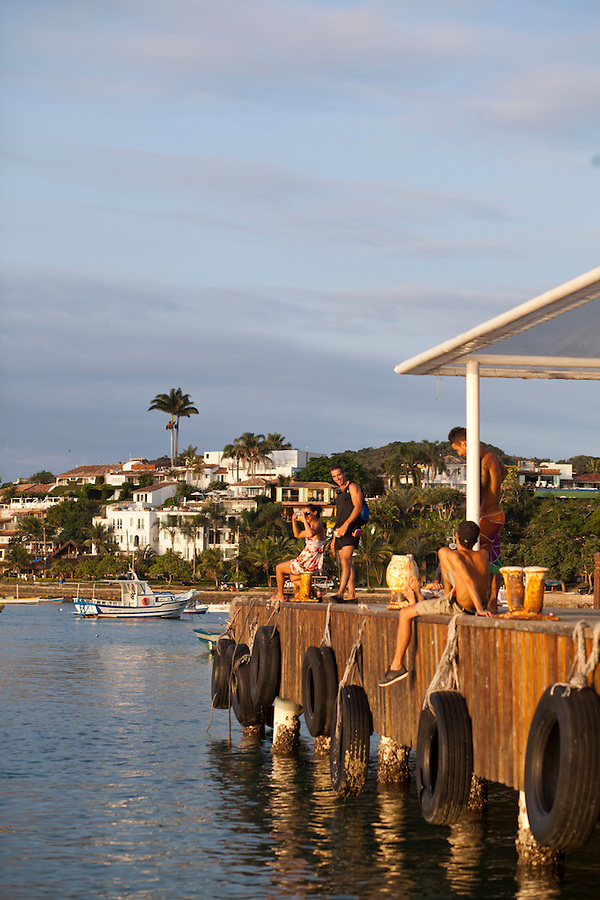 The dock in Buzios Bay, with a view of Casa Brancas Boutique Hotel and Spa
