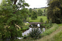 View of bridge over the river Wye and surrounding countryside at the Haddon Hall estate