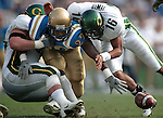(11-10-01) PASADENA--SPORTS--UCLA's #27 Akil Harris, center, tries to recover his own fumble as Oregon's #96 Chris Tetterton, left, and #16 Keith Lewis make the tackle during second quarter game action at the Pasadena Rose Bowl, Saturday. STAFF PHOTO BY Rodrigo Pena.