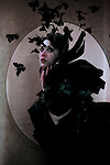 Young woman wearing black with butterflies