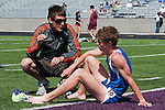 Timberline coach Ty Axtman talks to junior Brennen Keen following the YMCA Track and Field Invite 3200 meter run on April 28, 2012 at Rocky Mountain High School, Meridian, Idaho.