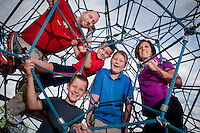 Stacy and Rich Johnson and their  boys,  Travis, 6, (red),  Cooper, 7, (grey) and Daniel 9, (blue) at Paseo Vista Park in Chandler.