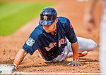 1 March 2017: Houston Astros outfielder Josh Reddick dives safely back to first during Spring Training action against the Miami Marlins at the Ballpark of the Palm Beaches in West Palm Beach, Florida. The Marlins defeated the Astros 9-5 in Grapefruit League play. Mandatory Credit: Ed Wolfstein Photo *** RAW (NEF) Image File Available ***