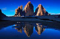 Mountain impression Tre Cime di Lavareddo mirrored in pond - Europe, Italy, South Tyrol, Sexten Dolomites, Tre Cime - July 2009 - Mission Dolomites Tre Cime