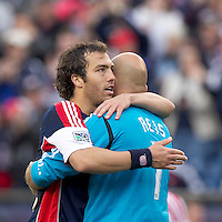 New England Revolution defender AJ Soares (5) and New England Revolution goalkeeper Matt Reis (1) celebrate their team victory. In a Major League Soccer (MLS) match, the New England Revolution defeated Portland Timbers, 1-0, at Gillette Stadium on March 24, 2012