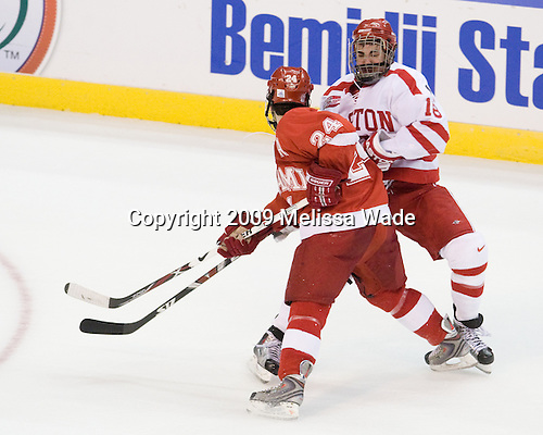 Kevin Roeder (Miami - 24), Brandon Yip (BU - 18) - The Boston University Terriers defeated the Miami University RedHawks 4-3 in overtime to win the 2009 NCAA D1 National Championship at the Frozen Four on Saturday, April 11, 2009, at the Verizon Center in Washington, DC.