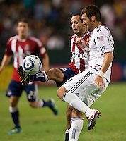 CARSON, CA – July 2, 2011: Chivas USA midfielder Nick LaBrocca (10) attempts to pass a ball past Chicago Fire defender Gonzalo Segares (13) during the match between Chivas USA and Chicago Fire at the Home Depot Center in Carson, California. Final score Chivas USA 1, Chicago Fire 1.