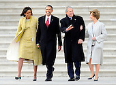 Washington, DC - January 20, 2009 -- (L-R) Michelle Obama, President Barack Obama, Former President George W. Bush and Laura Bush head to a Marine helicopter on the East Front of the US Capitol Building after Barack Obama was sworn in as the 44th President of the United States in Washington, DC, USA 20 January 2009.  Obama defeated Republican candidate John McCain on Election Day 04 November 2008 to become the next U.S. President..Credit: Tannen Maury - Pool via CNP