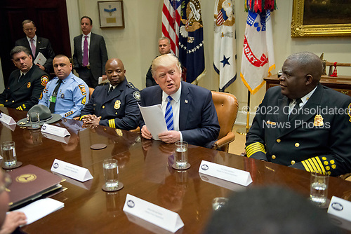 United States President Donald J. Trump meets with the I-85 bridge first responders in the Roosevelt Room of the White House in Washington, DC on Thursday, April 13, 2017.   <br /> Credit: Ron Sachs / Pool via CNP
