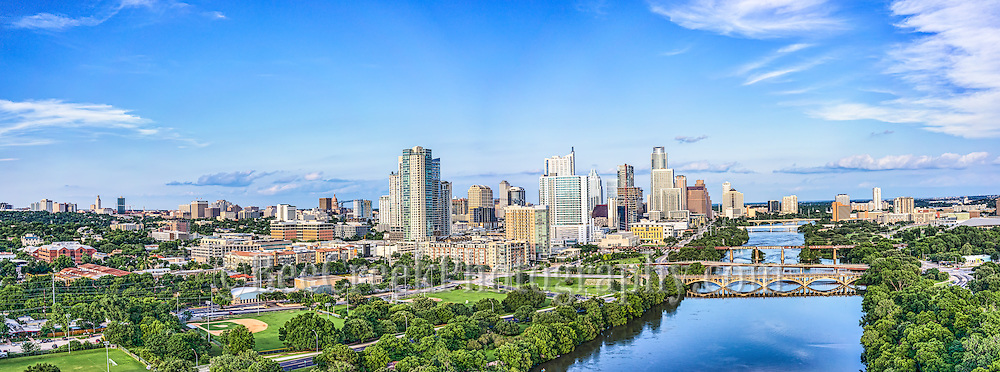 We capture this aerial Austin Skyline along Lady Bird Lake with the downtown area including the Texas Capital and the UT Tower in this Panorama.  The one day where we saw the sun come out in some time.  This image capture the view down Lady Bird Lake with the Lamar bridge, all the way to Congress with the city along the shoreline.