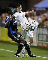 Chris Pontius of DC United controls the ball away from Nana Attakora of Earthquakes during the game at Buck Shaw Stadium in Santa Clara, California on July 30th, 2011.   DC United defeated San Jose Earthquakes, 2-0.