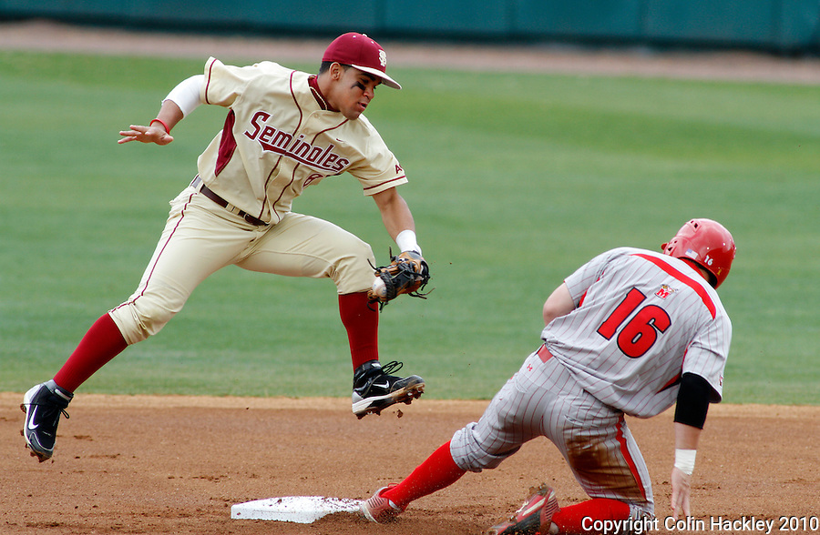 TALLAHASSEE, FL 3/28/10-FSU-MARY BASE10 CH-Florida State's Devon Travis comes down on second base from a high catch with the ball to make the second out of the first inning on Maryland's Matt Marquis Sunday at the Dick Howser Stadium in Tallahassee. The Seminoles beat the Terrapins 9-5...COLIN HACKLEY PHOTO