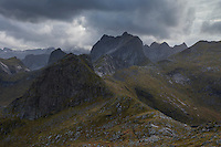 Rugged autumn mountain landscape of Moskenesøy from summit of Tverrfjellet, Lofoten Islands, Norway