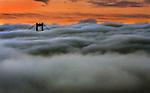 Fog settles around Golden Gate Bridge during the twilight hours in San Francisco, California.