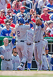 1 June 2014: Texas Rangers outfielder Leonys Martin is greeted at the dugout by Elvis Andrus (right) after scoring against the Washington Nationals at Nationals Park in Washington, DC. The Rangers shut out the Nationals 2-0 to salvage the third the third game of their 3-game inter-league series. Mandatory Credit: Ed Wolfstein Photo *** RAW (NEF) Image File Available ***