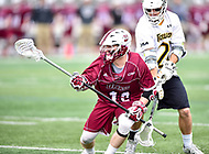 Towson, MD - May 6, 2017: Towson Tigers Mike Lynch (27) defends UMASS Minutemen Jake Lisauskas (16) during CAA Championship game between Towson and UMASS at Minnegan Field at Johnny Unitas Stadium  in Towson, MD. (Photo by Phillip Peters/Media Images International)