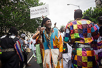 Sengalese immigrants participate in a parade in Harlem in New York commemorating their Shaykh Ahmadou Bamba during the Murid Islamic Community in America (MICA) cultural weeks celebration on Sunday, July 28, 2013. A Murid follows the philosophy of the Sufi Islamic religion and is guided by a murshid, in this case the late Shaykh Ahmadou Bamba who died in 1927.(© Richard B. Levine)