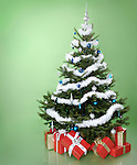 Decorated Christmas tree with gifts under it. Isolated on light green background.