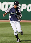 Seattle Mariners right fielder Ichiro Suzuki, of Japan, fields hits before the Mariner's s opening home game of the season with the Oakland Athletics at SAFECO Fieldin Seattle April 13, 2012.  © 2012. Jim Bryant Photo. All Rights Reserved.