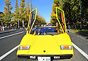 November 27, 2011, Tokyo, Japan - With its gulwing door open, a 1977 yellow Lamborghini Countach LP400 takes part in the fifth Classic Car Festa 2011 in Tokyo on Sunday, November 27, 2011. Some 43,000 spectators watch about 100 domestic and foreign classic and vintage cars parade the gingko-lined streets of the Meiji Shrines Outer Garden in the annual open-air exhibition and parade sponsored by Toyota Automobile Museum. (Photo by Natsuki Sakai/AFLO) [3615] -mis-
