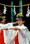 Young girls dance at Wakamiya Hachimangu shrine during the Kanamara matsuri or Iron Phallus festival in Kawasaki Daishi, Kanagawa, April 2nd 2006
