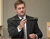 Montgomery County (Maryland) Police forensics specialist David McGill holds a rifle scope found in the Chevrolet Caprice when sniper suspect John Allen Muhammad was arrested during his testimony in courtroom 10 at the Virginia Beach Circuit Court in Virginia Beach, Virginia on November 3, 2003.<br /> Credit: Lawrence Jackson - Pool via CNP