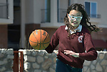 A student plays basketball in the Lydia Paterson Institute in El Paso, Texas. Most of the school's students travel across the border every day from their homes in Juarez, Mexico, to study at the United Methodist-sponsored high school.