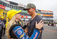 May 1, 2016; Baytown, TX, USA; NHRA funny car driver Courtney Force (left) celebrates with husband Graham Rahal after winning the Spring Nationals at Royal Purple Raceway. Mandatory Credit: Mark J. Rebilas-USA TODAY Sports