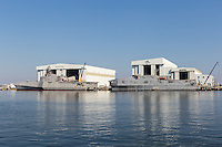 USS Manchester littoral combat ship and USNS Yuma expeditionary fast transport under construction at the Austal Shipyard in Mobile, Alabama.