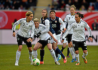 Offenbach, Germany, Friday, April 05 2013: Womans, Germany vs. USA, in the Stadium in Offenbach,  Saskia Bartusiak (GER),  Luisa Wensing (GER), Alex Morgan (USA), Nadine Kessler (GER)...