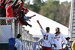 16 November 2008: Maryland's Jeremy Hall (17) celebrates his goal with Graham Zusi (11) and fans. The University of Maryland defeated the University of Virginia 1-0 at WakeMed Stadium at WakeMed Soccer Park in Cary, NC in the men's ACC tournament final.