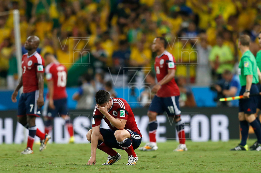 FORTALEZA - BRASIL -04-07-2014. Foto: Roberto Candia / Archivolatino<br /> James Rodriguez (#10) jugador de Colombia (COL) reacciona con desiluci&oacute;n despu&eacute;s de perder con Brasil (BRA) en partido de los cuartos de final por la Copa Mundial de la FIFA Brasil 2014 jugado en el estadio Castelao de Fortaleza./ James Rodriguez (#10) player of Colombia (COL) reacts with disappointment after losing with Brazil (BRA) in match of the Quarter Finals for the 2014 FIFA World Cup Brazil played at Castelao stadium in Fortaleza. Photo: Roberto Candia / Archivo Latino<br /> VizzorImage PROVIDES THE ACCESS TO THIS PHOTOGRAPH ONLY AS A PRESS AND EDITORIAL SERVICE IN COLOMBIA AND NOT IS THE OWNER OF COPYRIGHT; ANOTHER USE IS REPONSABILITY OF THE END USER. NO SALES, NO MERCHANDASING. ALL COPYRIGHT IS ARCHIVOLATINO