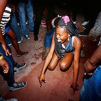 A young girl dancing to Kuduru/Kuduro music at disco. .