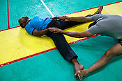 The Indian Kabbadi team-members are seen doing yoga and other stretch exercises after a game at a month long camp in Sport Authority of India Sports Complex in Bisankhedi, outskirts of Bhopal, Madhya Pradesh, India.