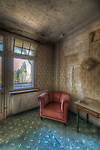 An old hotel in the Black Forest with chair in corner of room