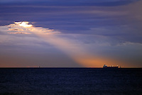 As a ship sets sail into the sunset and the storm clouds roll in, a single beam of light shines down like a search light.<br /> &quot;One second it was there the next it was gone this is the only shot I got&quot;.