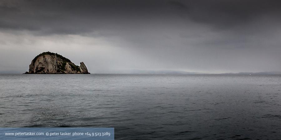 An Island midway between Elephant Cove Motukahaua Island, and Coromandel Harbour. Misty morning. Hauraki Gulf, Auckland, New Zealand.