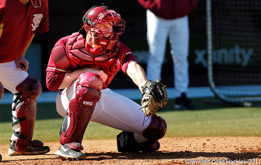TALLAHASSEE, FL 2/12/10-FSUBASE 021211 CH-Florida State catcher Stephen McGee snags a pitch during the Fan Day scrimmage Saturday at the Dick Howser Stadium in Tallahassee...COLIN HACKLEY PHOTO