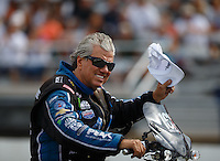 Aug 19, 2016; Brainerd, MN, USA; NHRA funny car driver John Force during qualifying for the Lucas Oil Nationals at Brainerd International Raceway. Mandatory Credit: Mark J. Rebilas-USA TODAY Sports
